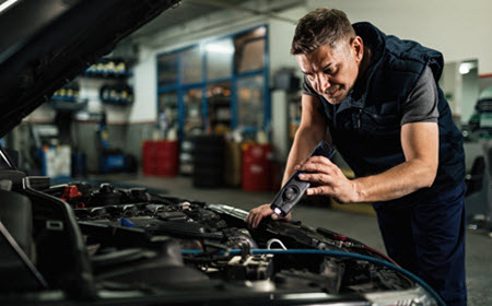 Infiniti Mechanic Checking Engine